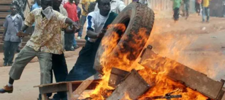 Rioters burn tyres and wood in Kampala.
