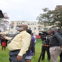 The Leader of the Opposition in Parliament, Betty Aol Acan, speaking to journalists during her visit to Makerere University on Tuesday, 22 September 2020. In the background is the burnt Ivory Tower