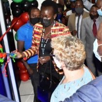 Ag. Executive Director UCC-Eng. Irene Sewankambo cuts the tape to commission the Mak Research Private Cloud Computing Facility on Friday 12th February 2021 at the College of Engineering Design Art and Technology. Second Right is Dr. Gity Behravan while Right is Prof. Tonny Oyana. The facility was established with funding from Sida.
