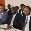 Tycoon Amos Nzeyi (R) with his lawyer (C) and son appearing before the committee