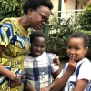 Minister Ruth Aceng ensures the daughter and relatives are immunized. Courtesy photo
