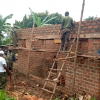 UPDF officers constructing a house