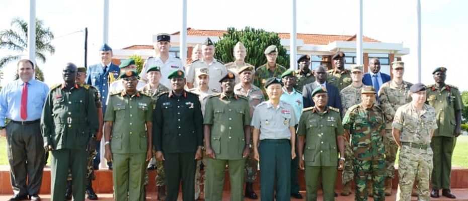 CDF Gen.David Muhoozi (Middle) with Defence Attaches and other UPDF officers shortly after the meeting. DPU photo