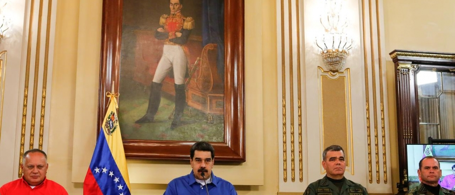 Venezuela's President Nicolas Maduro speaks next to Venezuela's National Constituent Assembly President Diosdado Cabello, Venezuela's Defense Minister Vladimir Padrino Lopez and Remigio Ceballos Strategic Operational Commander of the Bolivarian National Armed Forces, during a broadcast at Miraflores Palace in Caracas, Venezuela April 30, 2019. Miraflores Palace/Handout via. Courtesy photo