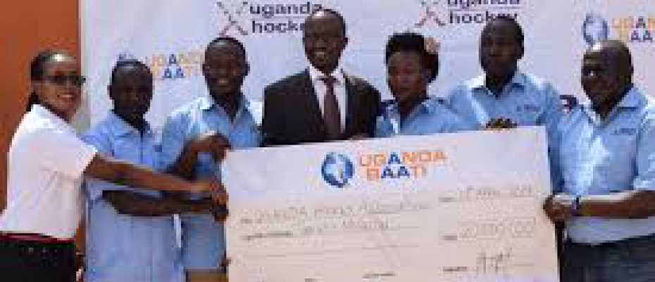 Uganda Baati officials handover dummy cheque to UHA team on Friday. Photo by Thomas odongo