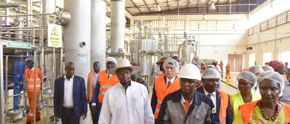 President Museveni is taken on a guided tour of Soroti Fruit Factory shortly after commissioning it on Saturday April 13, 2019