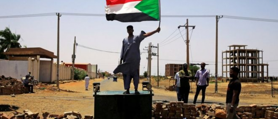 A Sudanese protester stands on a barricade in Khartoum on Wednesday. Courtesy photo