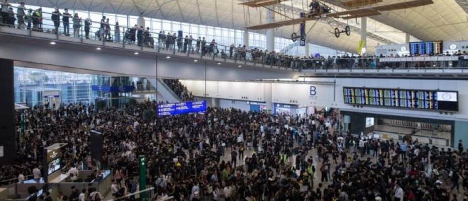 Protests swelled on the fourth day of the sit-in, with dozens of flights now cancelled. Courtesy photo