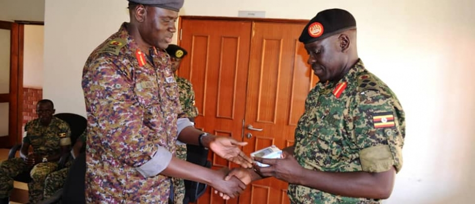 Outgoing URDCC Commandant Maj Gen Lokech (Left) handsover office to his successor Brig Gaetano Omola. DPU photo