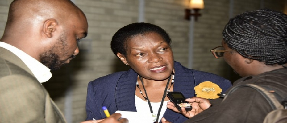Clerk to Parliament Jane Kibirige talking to journalists