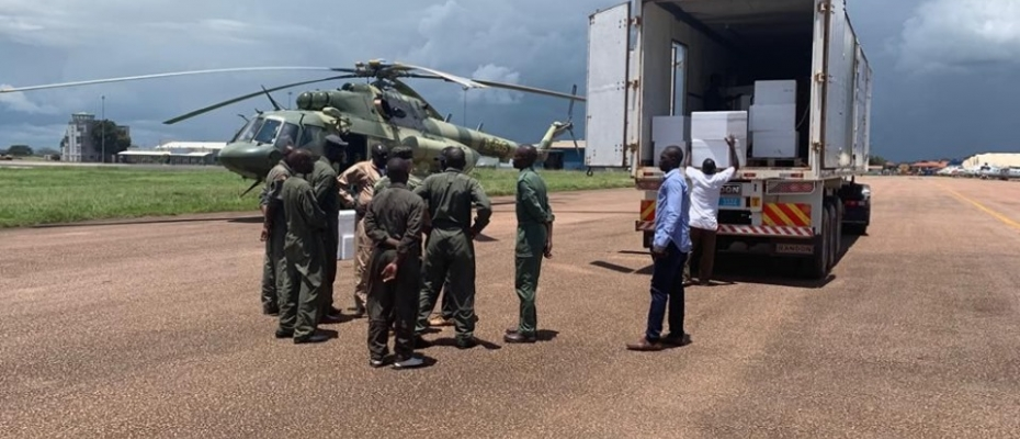 UPDF helicopters airlift the immunization vaccines on Sunday.DPU photo