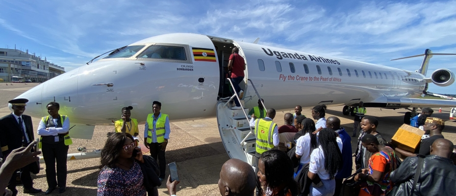 Passengers board one of Uganda Airlines' Bombardier CRJ900s at Entebbe Airport. Courtesy photo