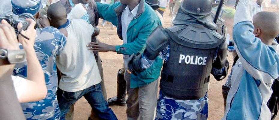 Besigye battles police during past protests. Courtesy photo