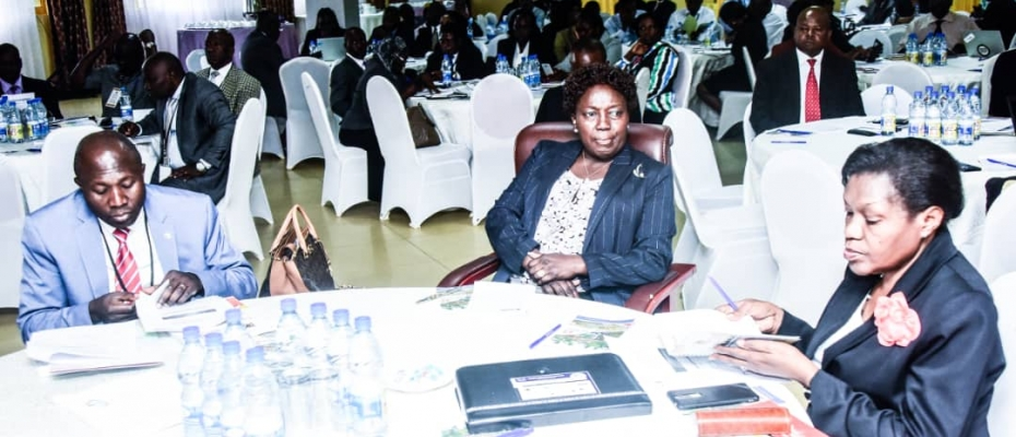 Speaker Rebecca Kadaga (C), Clerk Jane Kibirge and MP Nandala Mafabi (L) at the retreat