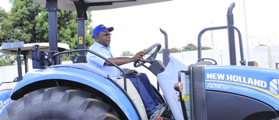 Eng. Simon Peter Mugerwa, the Technical and Sales Manager New Holland tractors on one of the tractors that will be exhibited at the harvest Money expo
