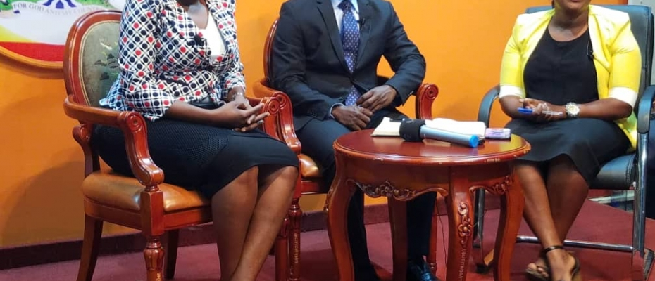 ICT Ministers Judith Nabakooba (L) and Peter Ogwang (C) being hosted live on Star TV