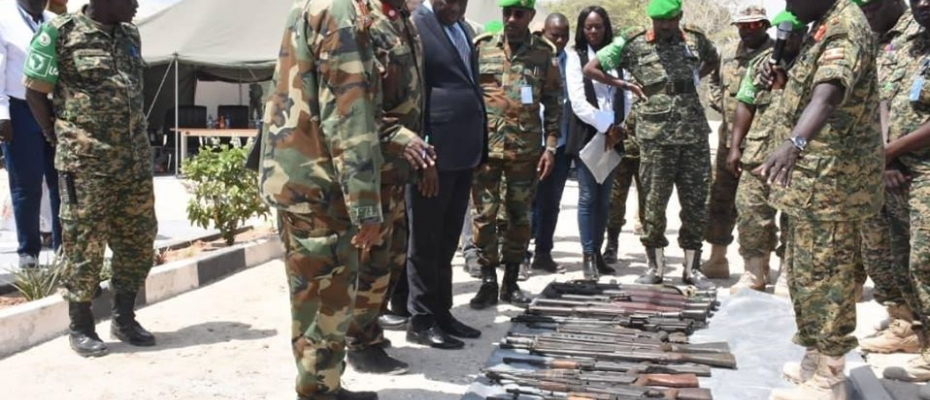 Ambassador Francisco Madeira and Other AMISOM officials inspect the recovered weapons. Courtesy photo
