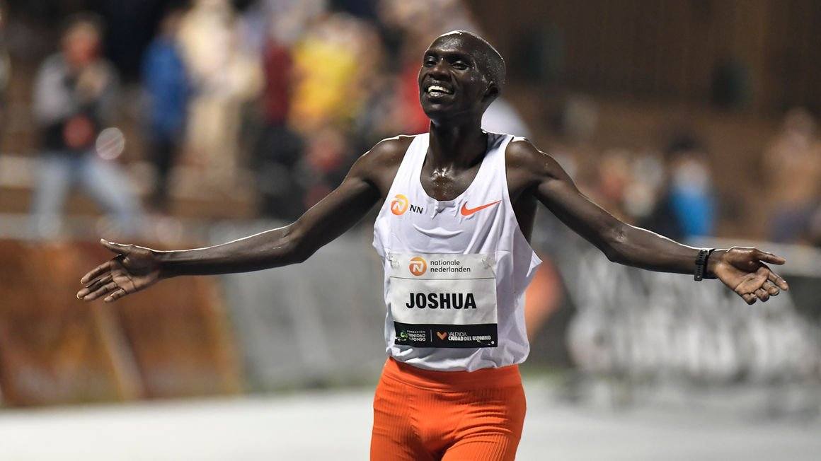 Ugandan athlete Joshua Cheptegei celebrates after breaking the 10,000m track world record during the NN Valencia World Record Day at the Turia stadium in Valencia
