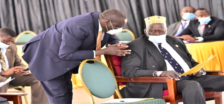First Deputy Prime Minister, Gen. Moses Ali (R) consulting with Hon. Godfrey Onzima, Aringa North County MP during the Tuesday, 27 April 2021 sitting