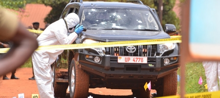 Forensic experts examine the scene of crime where Kaweesi was killed