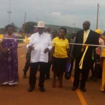 Muveni cutting the tape to launch Hoima USMID Project upgraded roads on Tuesday. Photo by Tugume Johnbosco