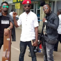 Kyadondo East MP Robert Kyagulanyi aka Bobi Wine with his crew at Entebbe before they flew to South Africa. Courtesy photo