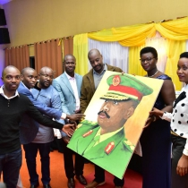 Gen Muhoozi Kainerugaba (Centre) receives a gift from the organizing committee of the party. Courtesy photo