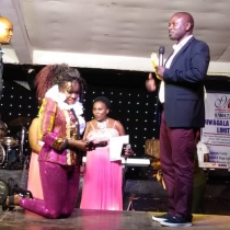 Maj Chris Magezi (Right) handing over the Shs10million envelope to singer Rebecca Jingo. Courtesy Photo