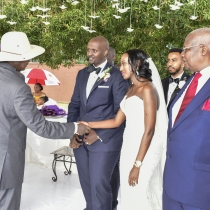 President Museveni shares a light moment with Isaac Kutesa and his wife Yvette after their wedding at Munyonyo on Saturday. Looking on (R) is Hon Sam Kutesa, father to the groom
