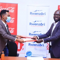 Benjamin Rukwengye, Founder and Chief Executive of Boundless Minds joins Melkamu Abebe, Head of Coca-Cola Beverages Africa in Uganda to launch the Elevate! youth mentorship program