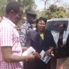 Ruth Achimo (C) during arrest in April. Courtesy photo