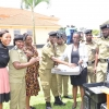 Ag Director Forensic Services SP Andrew Mubiru receiving the kits. Courtesy photo