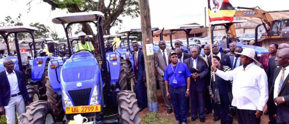 President Yoweri Museveni officially hands over  New Holland tractors at Namalere Agricultural Mechanisation Farm in Wakiso district recently