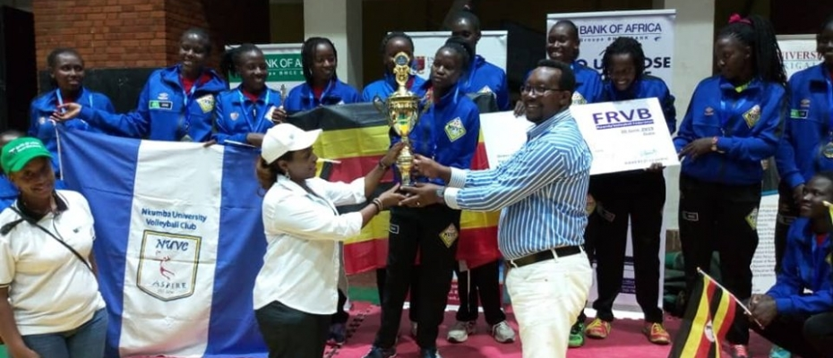 Champions Nkumba University being handed a trophy in Rwanda. Courtesy photo