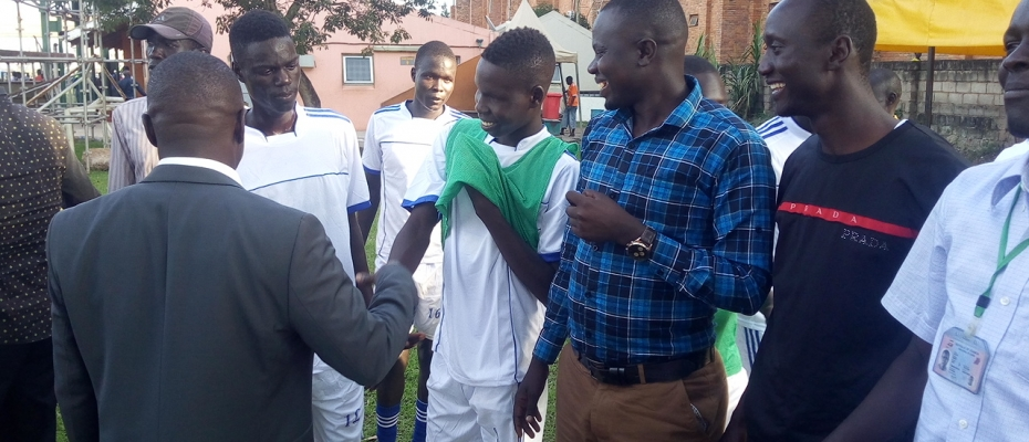 Ogwang lauds the Usuk players after a game against Proline Academy. Photo by Max Patrick Ocaido