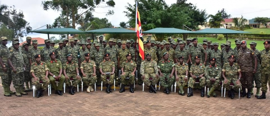 Gen Mbadi (Centre with flag) flagging off the UPDF Sports team to Kenya. DPU photo