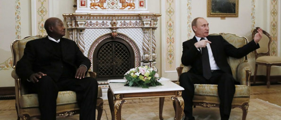 Russian President Vladimir Putin (right) speaks with Uganda's President Yoweri Museveni during their meeting at the Novo-Ogaryovo state residence outside Moscow on