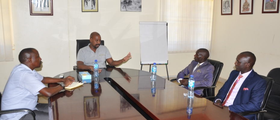 Gen Kainerugaba in a conversation with his vistor Gold medalist Joshua Cheptegei (R)