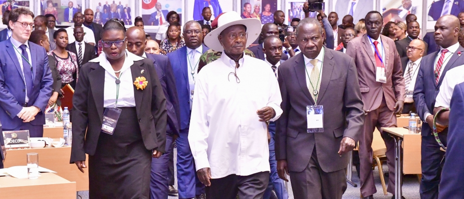 Museveni arrives for the conference flanked by Finance Minister Matia Kasaija (on his left) and URA Commissioner Gen Doris Akol ( on his right). PPU Photo