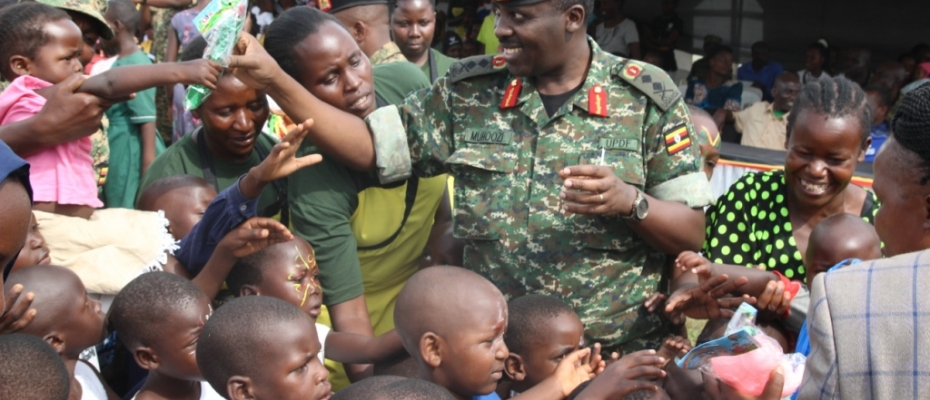 Gen Muhoozi gives gifts to UPDF children during the party. Courtesy photo