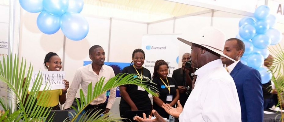 President Museveni interacting with young innovators during launch of the ICT Expo in Nakawa. PPU photo