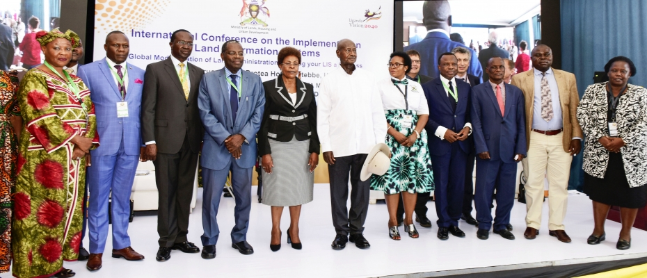 President Yoweri Museveni with Lands Minister Beti Kamya and other officials during the conference on Thursday. PPU photo